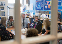 © Licensed to London News Pictures. 22/10/2014. London, UK. Nick Clegg talks with a group of teachers about the bureaucracy they face in school work. Deputy Prime Minister Nick Clegg visits a school, Bellville Primary in Clapham, in London on Wednesday 22 October to address an audience of public sector workers - including teachers, social workers, local government and NHS staff, Civil Service apprentices & Fast Streamers. He gave a speech about the public sector as a whole and in it, thanked public sector workers for their hard work through challenging financial times. Photo credit : Stephen Simpson/LNP