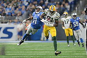DETROIT, MI - JANUARY 01: Packers wide receiver Geronimo Allison (81) makes a leaping grab in front of Lions cornerback Crezdon Butler (41) during a NFC North NFL football game between Detroit and Green Bay on January 1, 2017, at Ford Field in Detroit, MI. (Photo by Adam Ruff/Icon Sportswire)