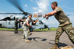 U.S. Soldiers and Sailors load water onto a U.S. Navy MH-60S Sea Hawk helicopter in Beaumont, Texas, Sept. 3, 2017. Hurricane Harvey formed in the Gulf of Mexico and made landfall in southeastern Texas, bringing record flooding and destruction to the region. U.S. military assets supported FEMA as well as state and local authorities in rescue and relief efforts.<br />