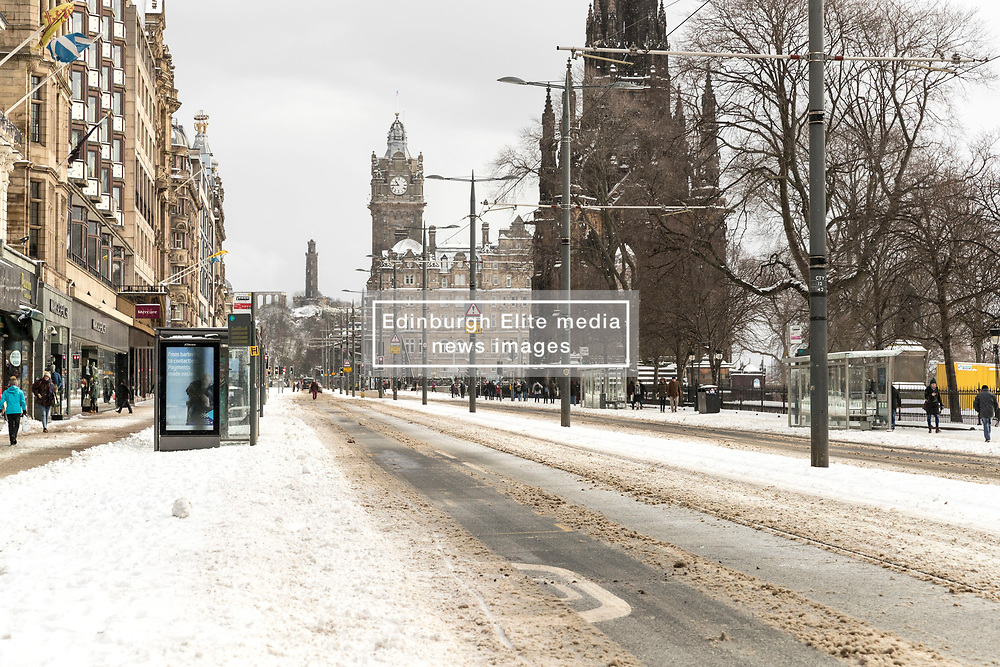 The Beast from the East, Storm Emma hit Edinburgh overnight and has left transport links decimated and many of the shops on the famous Princes Street closed for the day.<br /> <br /> Pictured: A deserted Princes Street with all buses and trams cancelled.