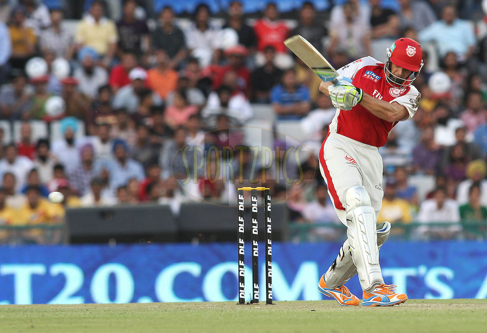 Captain Adam Gilchrist of the Kings XI Punjab pulls a delivery towards the boundary during match 9 of the Indian Premier League ( IPL ) Season 4 between the Kings XI Punjab and the Chennai Super Kings held at the PCA stadium in Mohali, Chandigarh, India on the 13th April 2011..Photo by Shaun Roy/BCCI/SPORTZPICS