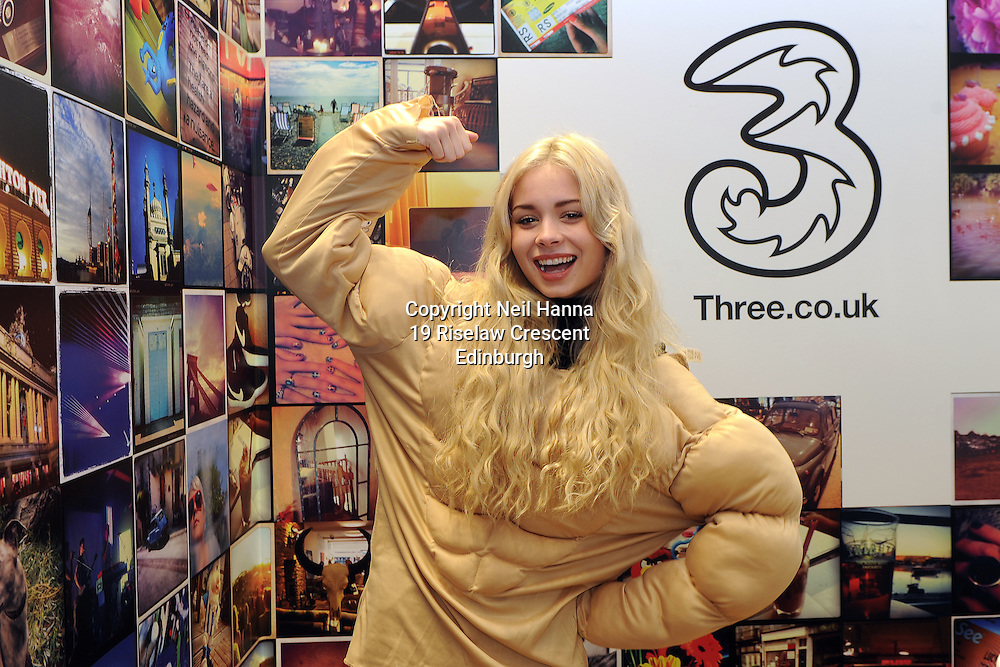 Three 'Calendar Me' app launch.<br /> Three store, Princes  Street, Edinburgh.<br /> <br /> Nina Nesbitt  joined in the fun as Three launch the &quot;Calendar Me' app across the UK. The app allows people to create the ultimate personalised calendar for 2015. <br /> In an act of pure self-indulgence, people will feature in a series of far-fetched scenarios, by simply uploading an image of their face, which can then be shared with friends and family online.<br /> To highlight the launch, across Three stores in the first week in December, customers had the opportunity to create their calendar  in-store, using a special green screen area and  some fun props  and all under the direction of Nina Nesbitt.<br /> <br />  Neil Hanna Photography<br /> www.neilhannaphotography.co.uk<br /> 07702 246823