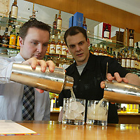 Edrington group.... Staff bar training by Angus Winchester (right) with Jason Craig<br /><br />Picture by Graeme Hart.<br />Copyright Perthshire Picture Agency<br />Tel: 01738 623350  Mobile: 07990 594431