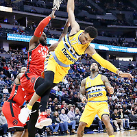 18 November 2016: Denver Nuggets guard Jamal Murray (27) fails after being blocked by Toronto Raptors forward Patrick Patterson (54) during the Toronto Raptors 113-111 OT victory over the Denver Nuggets, at the Pepsi Center, Denver, Colorado, USA.