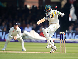Pakistan's Mohammad Abbas flicks the ball with his glove to get out from England's bowler Mark Wood during day three of the First NatWest Test Series match at Lord's, London.