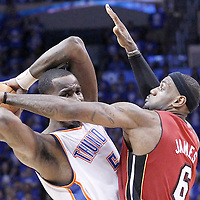 12 June 2012: Miami Heat small forward LeBron James (6) defends on Oklahoma City Thunder center Kendrick Perkins (5) during the Oklahoma City Thunder 105-94 victory over the Miami Heat, in Game 1 of the 2012 NBA Finals, at the Chesapeake Energy Arena, Oklahoma City, Oklahoma, USA.