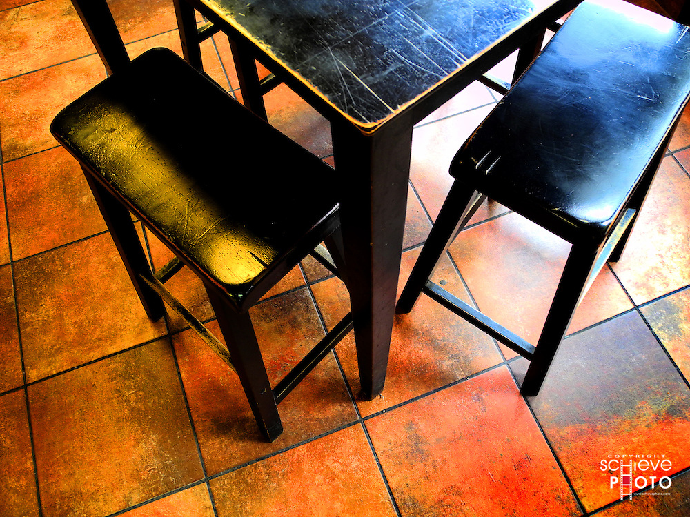 Black chairs and a table.