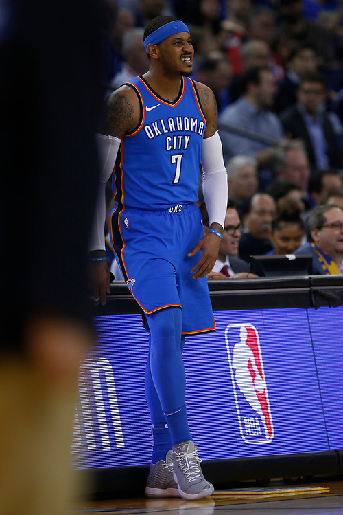 Oklahoma City Thunder forward Carmelo Anthony (7) during the first half of an NBA game between the Golden State Warriors and Thunder at Oracle Arena, Tuesday, Feb. 6, 2018, in Oakland, Calif. Anthony later left the game with a sprained right ankle.