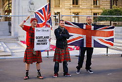 © Licensed to London News Pictures. 19/09/2014. Glasgow, UK. Unionist campaigners shouting at disappointed 'Yes' voters and campaigners as Scotland decides to stay in the union, at George Square in Glasgow on Friday, 19 September 2014, after the Scottish independence referendum. Photo credit : Tolga Akmen/LNP