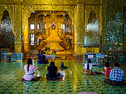 18 NOVEMBER 2017 - YANGON, MYANMAR: People pray at Botataung Pagoda in Yangon. Pope Francis is visiting Myanmar, September 27-30. It will be the first visit by a Pope to the overwhelmingly Buddhist nation. He will meet with the Aung San Suu Kyi and other political leaders and will participate in two masses in Yangon. The Pope is expected to talk about Rohingya issue while he is in Myanmar. The Rohingya are persecuted Muslim minority in Rakhine state in western Myanmar. It's not clear how Myanmar's politically powerful nationalist monks will react if the Pope openly talks about the Rohingya. In the past, the monks have led marches and demonstrations against foreign diplomatic missions when foreign ambassadors have spoken in defense of the Rohingya. There is not much visible sign of the Pope's imminent visit in Yangon, which is estimated to be more than 90% Buddhist.     PHOTO BY JACK KURTZ
