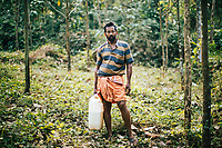 Neriamangalam, India -- February 18, 2018: A portrait of a toddy tapper in southern Kerala. Toddy tappers climb palm and coconut trees to gather the fermented alcohol at their tops.