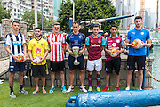 HKFC Citi Soccer Sevens Press conference at the historic Noon Day gun on Victoria Harbour Hong Kong. The one shot salute is a long standing Hong Kong tradition. HKFC Gary Gheczy holds the cup they will play for.Players L to R- Newcastle United Dan Barlaser,Wellington Phoenix Justin Gulley,Stoke City Lewis Banks,HKFC Gary Gheczy,West Ham Lewis Page,Aston Villa Khalid Abdo and Leicester City Elliott Moore