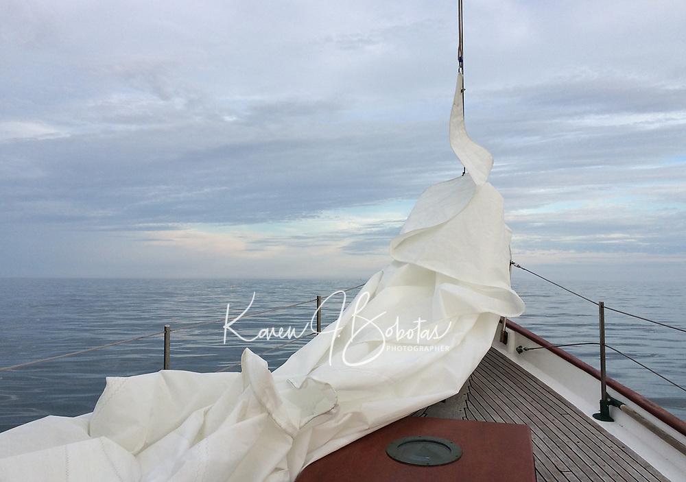 Nary a stitch of wind.....still a lovely sail just the same.  (Karen Bobotas/Photographer)