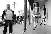 During the Fleadh in Derry 2013 ,one of the local Irish dancing schools had arranged to put on a performance throughout the afternoon .I was only trying to get a dancers view of the occasion and this woman benifited the photo by doing what shes doing .She stood staring at me for about 4 mins ,ain't people weird .
