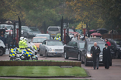 © Licensed to London News Pictures . 11/11/2012 . Lytham Park Crematorium , UK . Two police salute as the cortege enters the crematorium . Hundreds of strangers at the funeral of World War Two veteran Harold Jellicoe Percival today (Monday 11th November 2013) . The funeral is timed to coincide with the First World War armistice , the 95th anniversary of which is at 11am today (Monday 11th November 2013) . The RAF Bomber Command veteran died in his sleep on 25th October 2013 , aged 99 , at Alistre Lodge Nursing Home in St Annes , Lancashire , with no immediate family . Photo credit : Joel Goodman/LNP