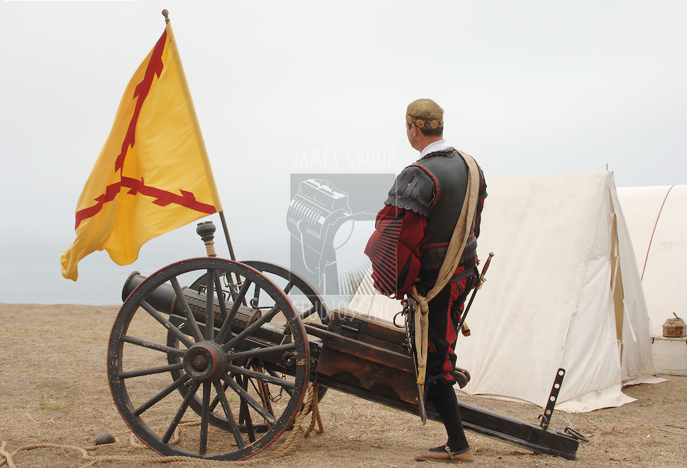 16th Century Spanish Soldier on the coast of Spain with a cannon bearing the Cross of Burgundy