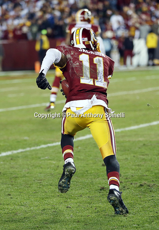 Washington Redskins wide receiver DeSean Jackson (11) runs toward his own goal line as he returns a fourth quarter punt, fumbles the ball, and turns it over to the Dallas Cowboys during the 2015 week 13 regular season NFL football game against the Dallas Cowboys on Monday, Dec. 7, 2015 in Landover, Md. The Cowboys won the game 19-16. (©Paul Anthony Spinelli)