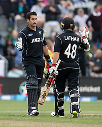New Zealand's Ross Taylor, left, celebrates reaching his century with Tom Latham in the fourth one day cricket international at the University of Otago Oval, Dunedin, New Zealand, Wednesday, March 7, 2018. Credit:SNPA / Adam Binns ** NO ARCHIVING**