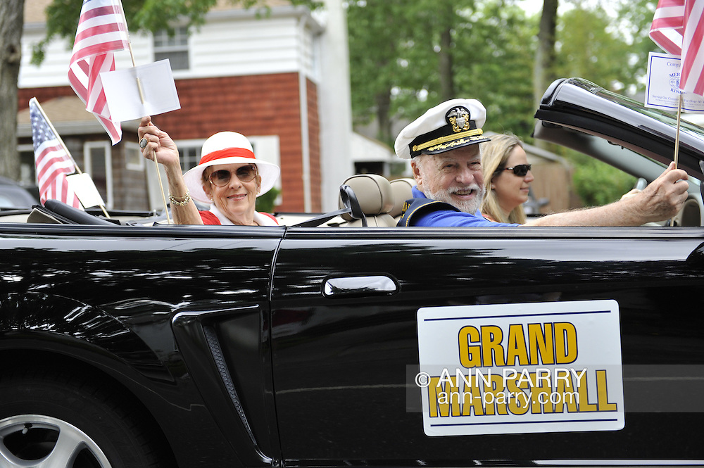 Parade Grand Marshall Everett A. Rosenblum (right) rode in a classic car with his wife (left) in the Merrick Memorial Day Parade on Monday, May 28, 2012, on Long Island, New York, USA. America's war heroes are honored on this National Holiday.