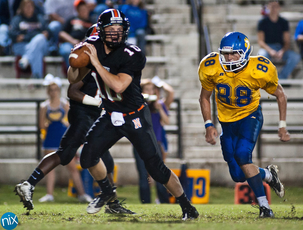 Northwest Cabarrus quarterback looks to pass as Mount Pleasant's Deon Pillsbury comes from behind to sack him Friday night at Northwest Cabarrus High School. (Photo by James Nix)