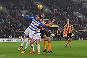 Hull City defender Michael Hector (5) and Reading FC defender Tiago Ilori (20) and Reading FC forward Yann Kermorgant (18)  during the EFL Sky Bet Championship match between Hull City and Reading at the KCOM Stadium, Kingston upon Hull, England on 13 January 2018. Photo by Ian Lyall.