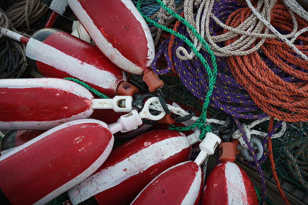 A collection of lobster buoys and fishing tackle on a pier in Bernard, ME USA
