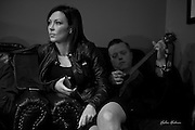Amanda Shires and husband Jason Isbell share a chair backstage before playing for the 2015 Benefit Concert for Nashville-based charity Ride for Reading.