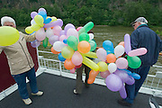 Passengers helping to prepare balloons for the party at Tulln...M.S. Johann Strauss, a brand new four star+ river cruiser operated by Austrian River Cruises, and chartered by Club 50 (a travel agency especially for seniors aged 50 and up) undertook an epic 3-week journey (May 21 to June 10, 2004) all the way from Amsterdam to the Black Sea?along Rhine, Main and Danube?, presumably the first passenger vessel ever to have done so. This is one of the images recorded during this historic voyage.