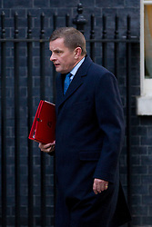 © Licensed to London News Pictures. 26/11/2013. London, UK. The Welsh Secretary, David Jones, arrives for a meeting of British Prime Minister David Cameron's Cabinet on Downing Street in London today (26/11/2013). Photo credit: Matt Cetti-Roberts/LNP