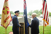 Robert Cutler®, executive director of the Bakers Creek Memorial Association's U.S. branch, speaks with Australian Air Commodore Gary Martin(L) before a ceremony marking 71th anniversary of a crash that killed 40 Army Air Corps members at Bakers Creek, Australia at Joint Base Myer-Henderson Hall in Arlington, Va. on June 13, 2014. Photo by Kris Connor