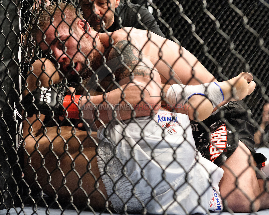 "LAS VEGAS, NEVADA, MAY 24, 2008: Rich Clementi (top) pounds on a downed Terry Etim during ""UFC 84: Ill Will"" inside the MGM Grand Garden Arena in Las Vegas"