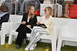 Left to right, sisters OLYMPIA CAMPBELL and EDIE CAMPBELL  at the Audi Polo Challenge at Coworth Park, Blacknest Road, Ascot, Berkshire on 31st May 2015.