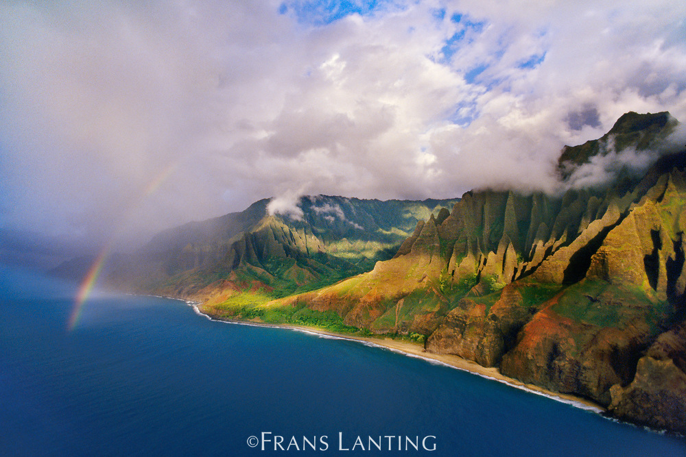 Rainbow over Na Pali coast (aerial), Kauai, Hawaii