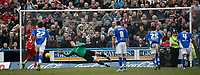Chesterfield keeper Barry Roche fails to save Junior Agogo's penalty