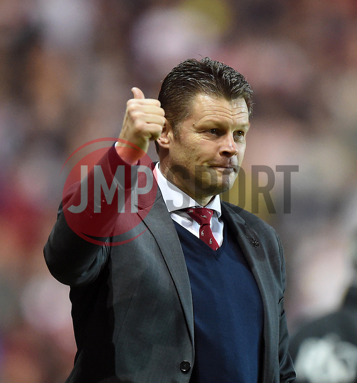 Bristol City manager Steve Cotterill gives supporters a thumbs-up as City lead Swindon 3-0 with minutes to go - Photo mandatory by-line: Paul Knight/JMP - Mobile: 07966 386802 - 07/04/2015 - SPORT - Football - Bristol - Ashton Gate Stadium - Bristol City v Swindon Town - Sky Bet League One