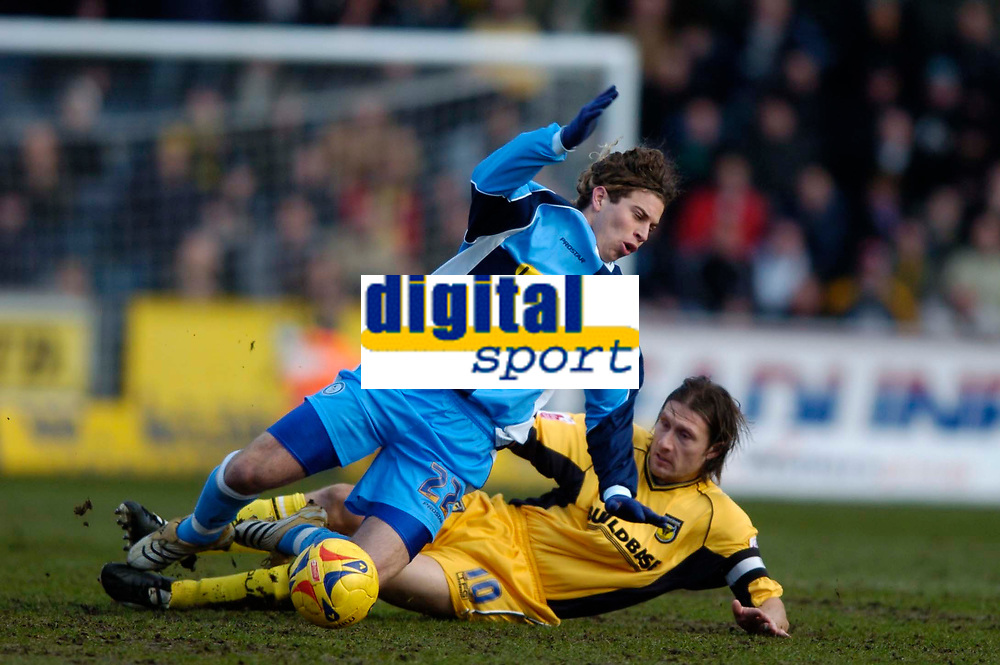 Photo: Richard Lane.<br />Wycombe Wanderers v Oxford United. Coca Cola League 2. 25/02/2006. <br />Wycombe's Sergio Torres (L) is tackled by Oxford's Chris Hargreaves.