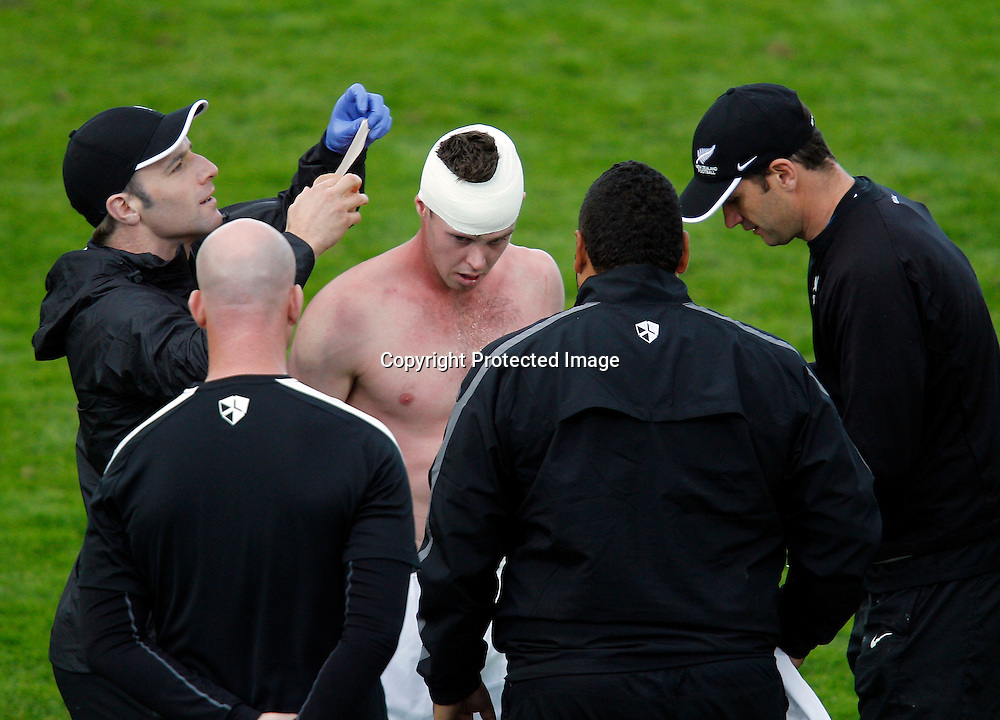 NZ's Adam McGeorge gets some running repairs. OFC Men's Olympic Qualifier New Zealand 2012, New Zealand v Papua New Guinea, Owen Delany Park Taupo, Friday 16th March 2012. Photo: Shane Wenzlick