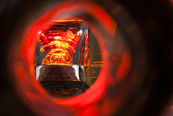 """""""Beauty at the Bottom: Tequila 16"""" - This is a photograph of a tequila bottle, shot right down inside the mouth of the bottle"""