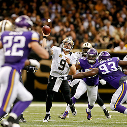 Sep 21, 2014; New Orleans, LA, USA; New Orleans Saints quarterback Drew Brees (9) is pressured to throw by Minnesota Vikings defensive tackle Shamar Stephen (93)during the second half of a game at Mercedes-Benz Superdome. The Saints defeated the Vikings 20-9. Mandatory Credit: Derick E. Hingle-USA TODAY Sports