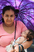 A woman holds her baby girl as she leaves after a vaccination session at the primary school in the town of Coyolito, Honduras on Wednesday April 24, 2013.