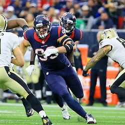 Nov 29, 2015; Houston, TX, USA; New Orleans Saints quarterback Drew Brees (9) is sacked by Houston Texans defensive end J.J. Watt (99) during the second half of a game at NRG Stadium. The Texans defeated the Saints 24-6. Mandatory Credit: Derick E. Hingle-USA TODAY Sports