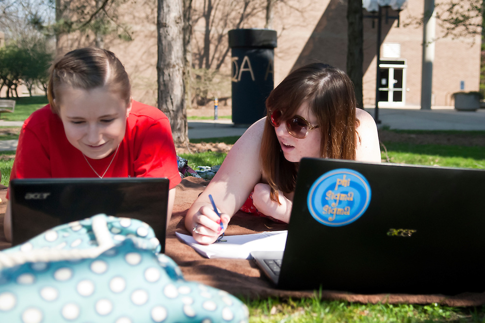 Lathan Goumas | MLive.com..March 21, 2012 - University of Michigan - Flint students Paige Murray, 19, of Waterford and Jessica Woodruff, 20, of Grand Blanc Township do homework outside while enjoying the unseasonably warm weather in Flint on Wednesday.