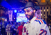 May 20, 2015 - New York, NY. William Hartley enjoys Game 3 of Rangers VS Tampa, in Bryant Park. Photograph by Anthony Kane/NYCity Photo Wire