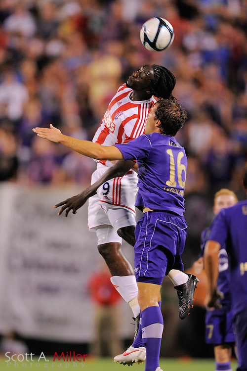 Stoke City Potters forward Kenwyne Jones (9) goes airborne with Orlando City Lions defender Wes Allen (16) during the Potters 1-0 win at the Florida Citrus Bowl on July 28, 2012 in Orlando, Florida. ..©2012 Scott A. Miller.