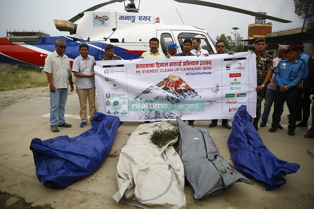 May 23, 2019, Kathmandu, Nepal: A 12-member team including Nepal Army personnel brings four dead bodies on a helicopter for post mortem after being located during the Mount Everest cleanup campaign to clean the world's highest peak at Teaching Hospital in Kathmandu. Two mountaineers have died on Mount Everest after crowds of people became stuck in a queue leading to the summit of the world's highest mountain. (Credit Image: © Skanda Gautam/ZUMA Wire)