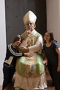 ITA.MWdrv05.034.xrw..Life-sized statue of Pope Pius II in Pienza, Italy, with Jennifer Zaid and Faith D'Aluisio taken during revisit with the Pellegrini family, 2005. Pope Pius II's given name was Enea Silvio de Piccolomini, (known in literature as Aeneas Silvius) Roman Catholic Pope from 1458 to 1464, born in what is now called Pienza. In 1996, UNESCO declared the town a World Heritage Site...