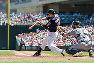 Minnesota Twins 1st baseman Justin Morneau connects for a home run against the Cleveland Indians at Target Field in Minneapolis, Minnesota on July 29, 2012.  The Twins defeated the Indians 5 to 1.  © 2012 Ben Krause