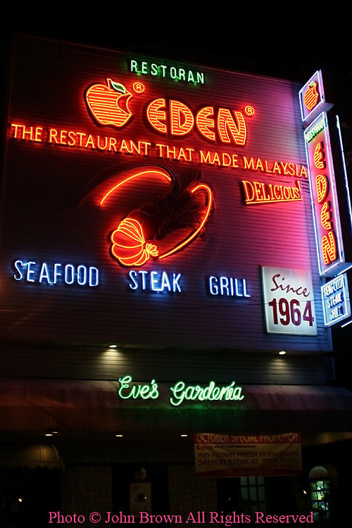 A bright neon sign marks the location of the Eden Steak and Seafood Restaurant, a landmark in Georgetown, Penang, Malaysia since 1964.
