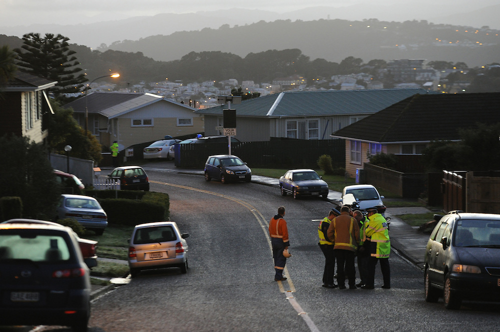 Police have evacuated houses in Precilla Cresent, Beramphore, after a slip caused by a broken watermain is threatening houses, Wellington, New Zealand, Saturday, June 01, 2013. Credit:SNPA / Ross Setford