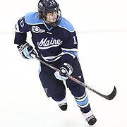 Ben Hutton #10 of the Maine Black Bears on the ice during the game at Matthews Arena on February 22, 2014 in Boston, Massachusetts. (Photo by Elan Kawesch)